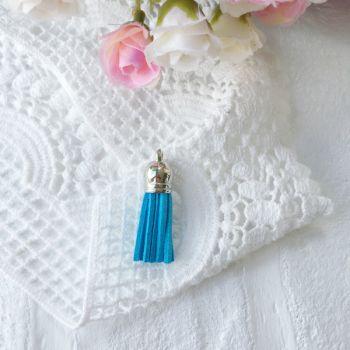 Замшевая кисточка 38 мм, цвет ярко-голубой/серебряный колп.