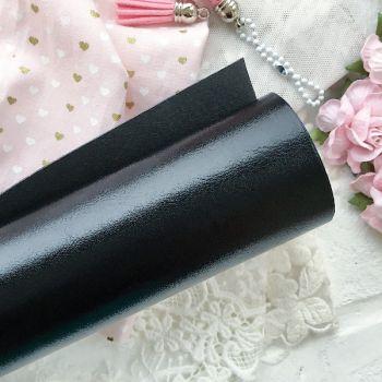 Глянцевый переплетный кожзаменитель, цвет черный 35*25 см